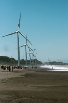 Free Wind Mills Near The Body Of Water Stock Images - 114321094
