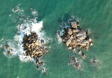 Free Bird S Eye View Of Rocks In Ocean Royalty Free Stock Image - 114321106