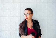 Free Woman In Black Leather Jacket Wearing Eyeglasses Holding Coffee Cup Royalty Free Stock Photography - 114321127