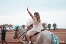 Free Woman Riding On White Horse Stock Image - 114321191