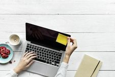 Free Person Holding Black And Grey Laptop Computer On Top Of White Wood Surface Stock Images - 114321244