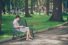 Free Photo Of Woman Wearing Gray Dress Sitting On Bench Royalty Free Stock Image - 114378466