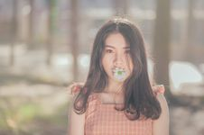 Free Photo Of Woman With Flower On Her Mouth Royalty Free Stock Photos - 114378468