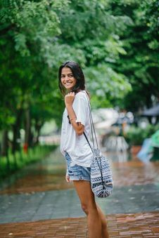 Free Shallow Focus Photography Of Woman In White Shirt And Blue Denim Shorts On Street Near Green Trees Royalty Free Stock Photos - 114378578