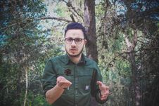 Free Man Wearing Green Dress Shirt And Surrounded By Trees Stock Image - 114378601
