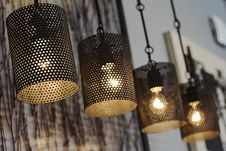 Free Four Black Turned On Pendant Lamps Royalty Free Stock Photo - 114378605