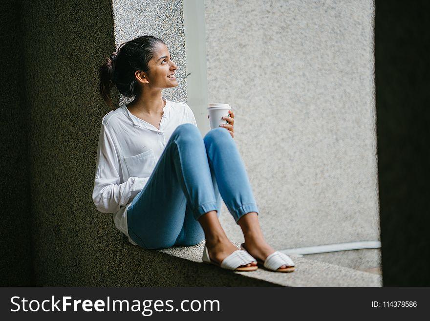Woman posing. Wearing White Dress Shirt Sitting on Window