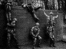 Free Grayscale Photography Of Soldiers Climbing Over Fence Stock Photo - 114442900