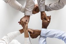 Free Photo Of Four Persons Uniting Hands Royalty Free Stock Photography - 114442947
