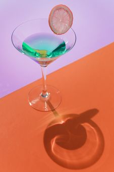 Free Clear Cocktail Glass On Orange Surface Stock Photo - 114443070