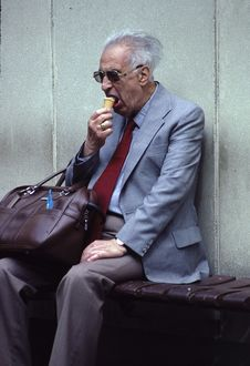 Free Man In Grey Suit Eating Ice Cream Royalty Free Stock Photography - 114443077