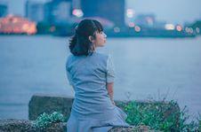 Free Woman Wearing Gray Dress Sitting Near Body Of Water Stock Photos - 114510603
