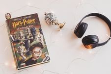 Free Harry Potter Book And Black Headphones With Trinket Stock Photography - 114510622