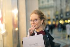 Free Close-Up Photography Of A Woman Holding Paper Bags Stock Photography - 114510632