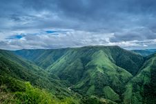 Free Landscape Photography Of Green Mountains Under Cloudy Sky Stock Photography - 114510722