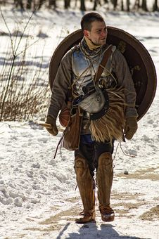 Free Man Wearing Armor And Walking In Snowy Field Royalty Free Stock Photos - 114510838