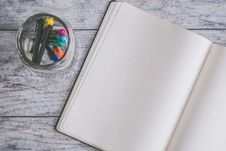 Free Photo Of Blank Note Book Near Clear Jar Royalty Free Stock Photos - 114510888