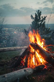 Free Photo Of Bonfire Placed On High Ground In Front Of City Under Cloudy Sky Stock Photo - 114510940