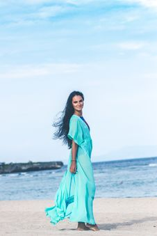 Free Woman In Teal Dress On Seashore Royalty Free Stock Photo - 114510945