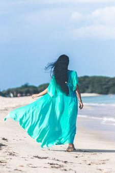 Free Woman Wearing Teal Dress While Walking Near Body Of Water Royalty Free Stock Image - 114511016