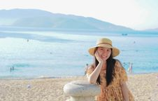 Free Woman Wearing Yellow Floral Dress And Sun Hat On Beach Stock Photography - 114603022