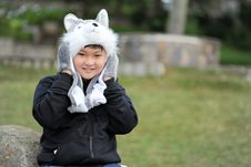 Free Kid Wearing Gray Wolf Critter Hat And Black Jacket Royalty Free Stock Photos - 114603048