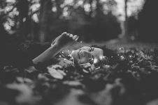 Free Grayscale Photo Of Person Lying On Ground Stock Image - 114603221