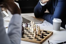 Free Photo Of Brown Wooden Chess Set On Table Beside White And Gray Disposable Cup Royalty Free Stock Photos - 114603258
