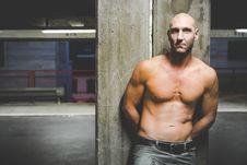 Free Photography Of A Shirtless Man Leaning On Wall Stock Photography - 114603272