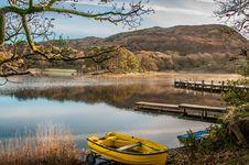 Free Landscape Photography Of Yellow Punt Boat On Shoreline Royalty Free Stock Image - 114603326