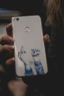 Free Person Holds Silver Huawei P9 Lite Smartphone Stock Image - 114603411