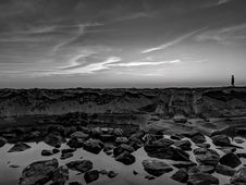 Free Grayscale Photo Of Person Walking On Rocks Royalty Free Stock Photo - 114603415