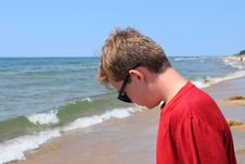 Free Photo Of Boy Wearing Red Shirt And Sunglasses On Seashore Royalty Free Stock Photo - 114677555