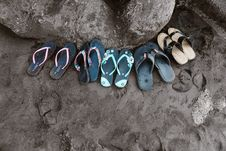 Free Assorted Flip-flops On Sand Royalty Free Stock Image - 114677576