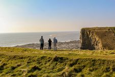 Free Three People On Top Of Hill Near Body Of Water Stock Photography - 114677782