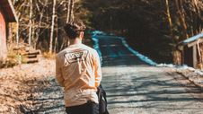 Free Person Wearing Beige Vans Long-sleeved Shirt Near House Royalty Free Stock Images - 114677829
