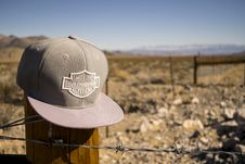 Free Gray Harley-davidson Motorcycles Flat-brimmed Cap Hanged On Brown Wooden Fence With Gray Barb Wires Stock Images - 114750864