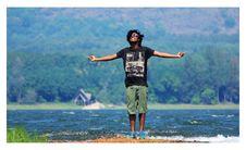 Free Man Spreading Arm On River Photograph Stock Photos - 114751013
