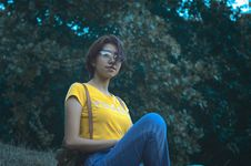 Free Woman In Yellow Short-sleeved Top And Blue Denim Jeans Royalty Free Stock Image - 114751036