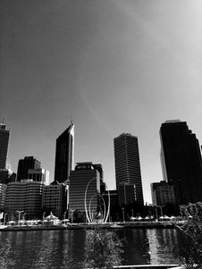Free Grayscale High-rise Building Mirrored On Calm Body Of Water Royalty Free Stock Photography - 114751047