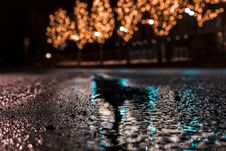 Free Selective Focus Photography Of Asphalt Road With Water Droplets Near City Lights During Nighttime Stock Image - 114751081