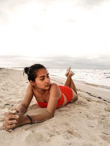 Free Woman Wearing Red Bikini Laying On Beach Sand Stock Photo - 114751270