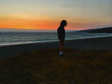 Free Person Standing On Seashore During Sunset Royalty Free Stock Photography - 114825467