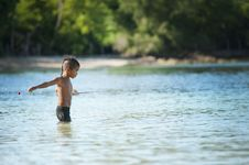 Free Topless Boy Wearing Black Shorts Standing On Bodies Of Water Royalty Free Stock Photography - 114825497