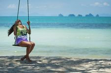 Free Woman In Green And Purple Tank Top Sitting On Brown Swing Stock Photos - 114825533