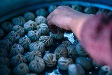 Free Person Holding Dumplings Stock Image - 114825541