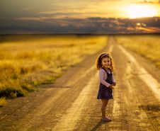 Free Girl Standing In The Middle Of The Road Royalty Free Stock Image - 114825566