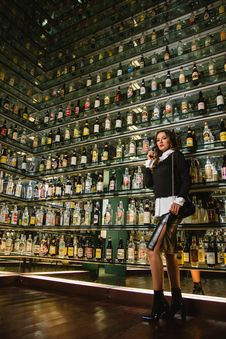 Free Photo Of Woman Standing Near Shelves For Liquor Stock Photos - 114825633