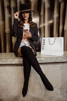 Free Photo Of Woman Sitting Near Paper Bag Royalty Free Stock Image - 114825636