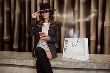 Free Photo Of Woman Sitting Near Paperbag Royalty Free Stock Photo - 114825665